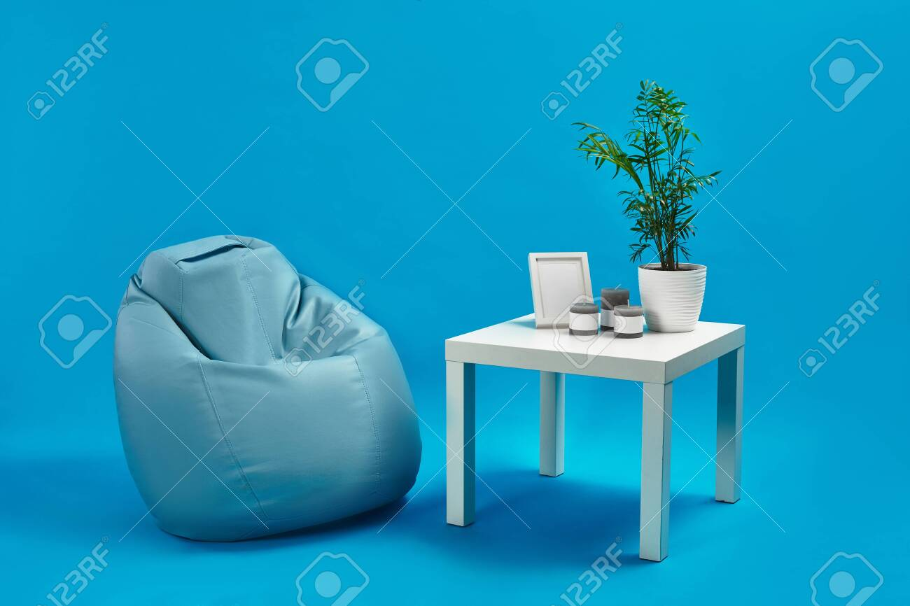 Leather Turquoise Armchair Bean Bag And White Coffee Table With Stock Photo Picture And Royalty Free Image Image 141994623