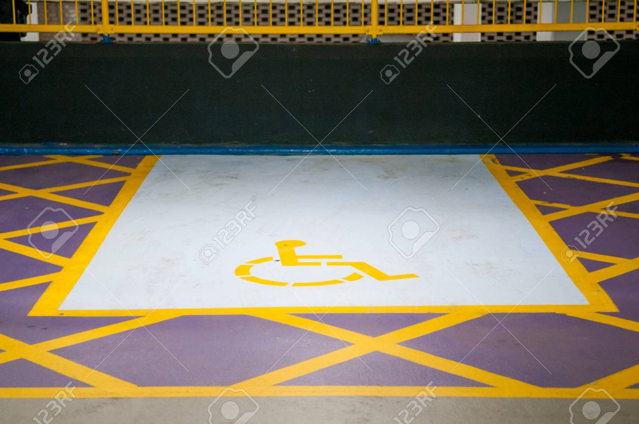 Disabled Parking Space Symbol In A Car Park Stock Photo Picture And