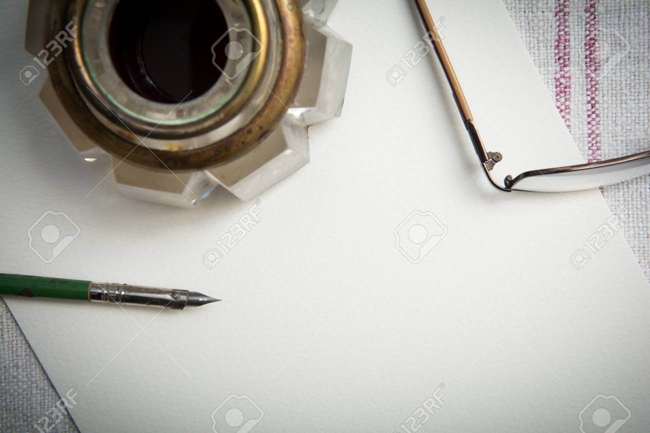 vintage style writing paper and pen with ink well and fountain