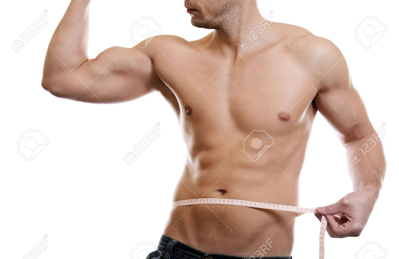 Muscular man measuring waist on white
