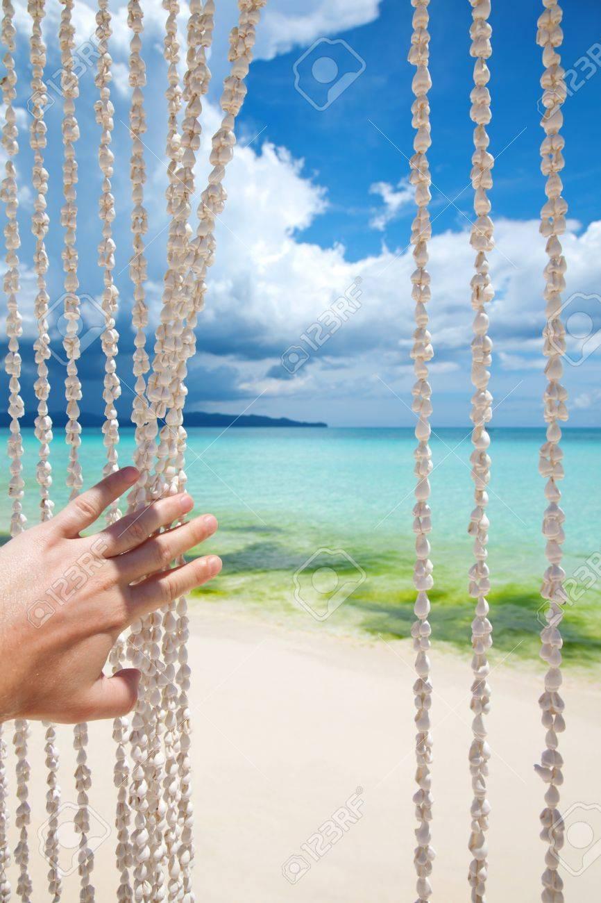 Paradise beach through a sea shell curtain Stock Photo - 14162129