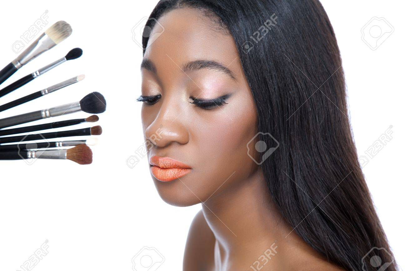 Closeup portrait of a young African beauty and make up brushes Stock Photo - 15489309