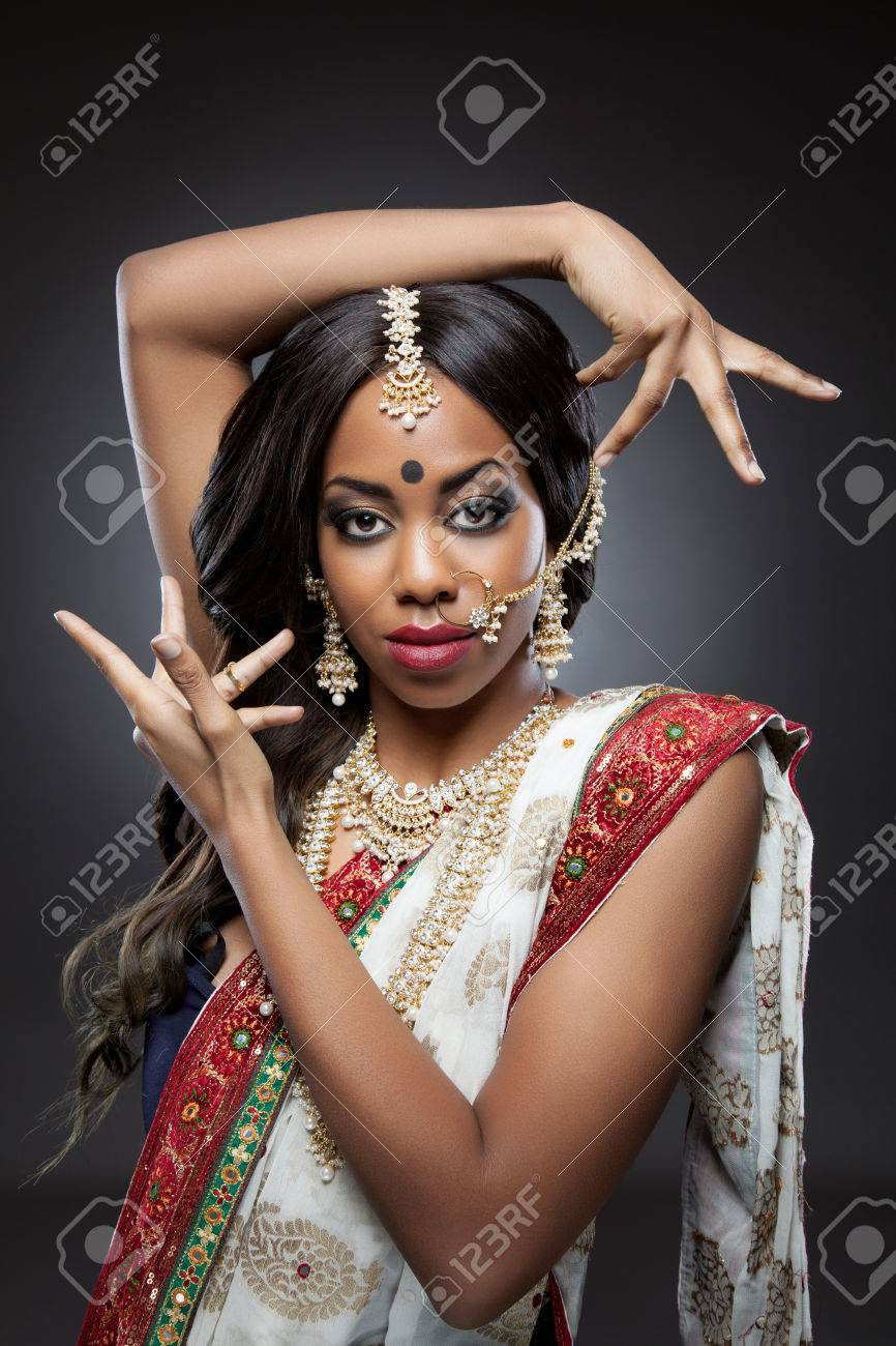 Young Indian woman dressed in traditional clothing with bridal