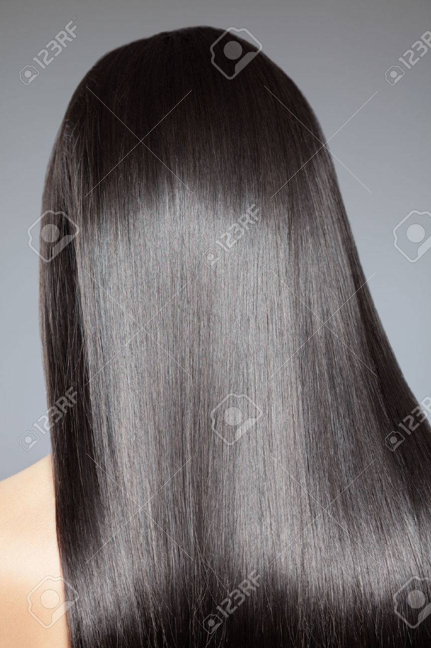 Back view of a woman with long straight hair - 36958681