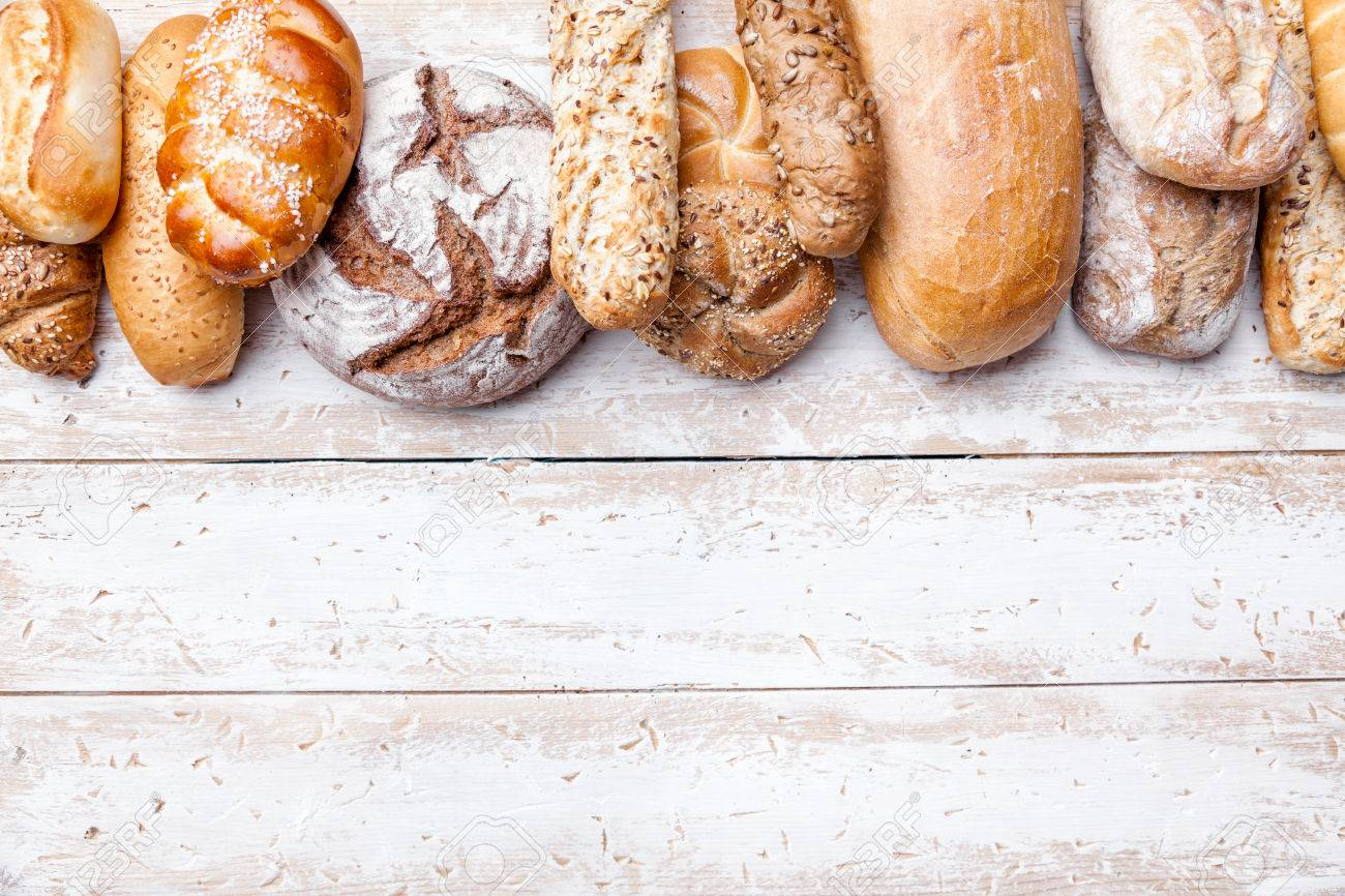 Delicious freshly baked bread on wooden background - 60786510