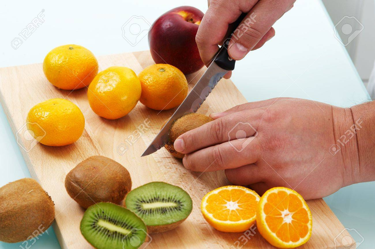Cutting different fruits with kitchen knife Stock Photo - 4047976