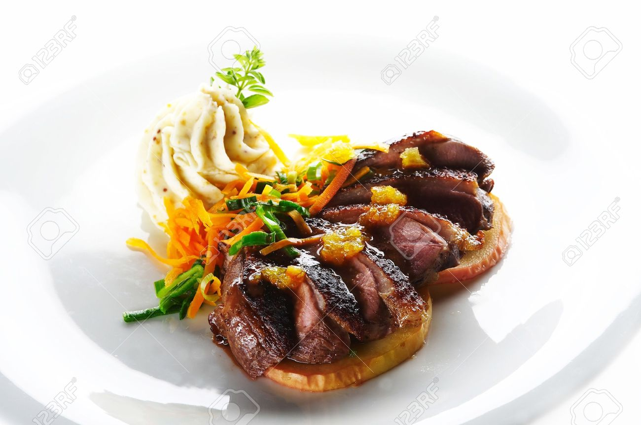 Roast duck with mashed potato cream and vegetable Stock Photo - 4065205