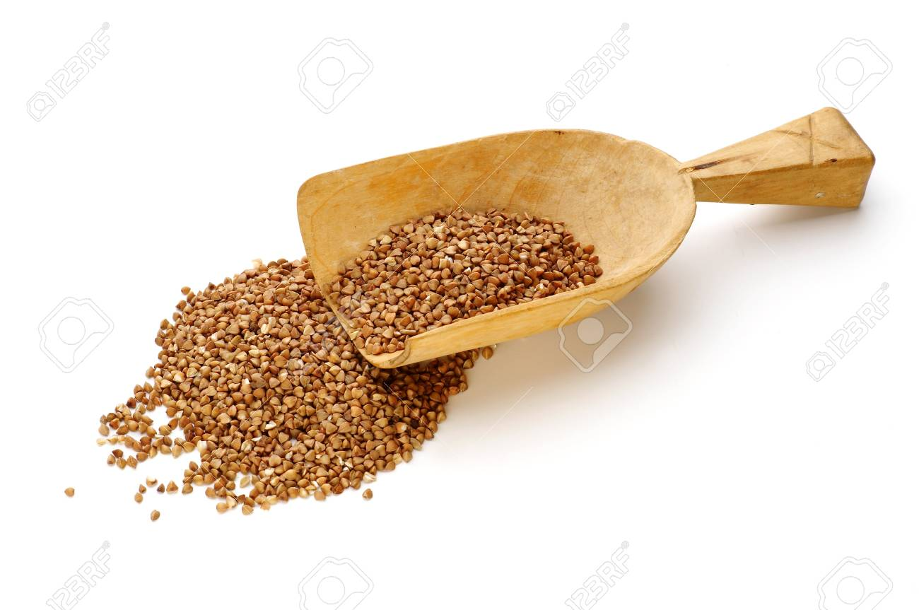Buckwheat with small wooden shovel isolated on white Stock Photo - 4065234