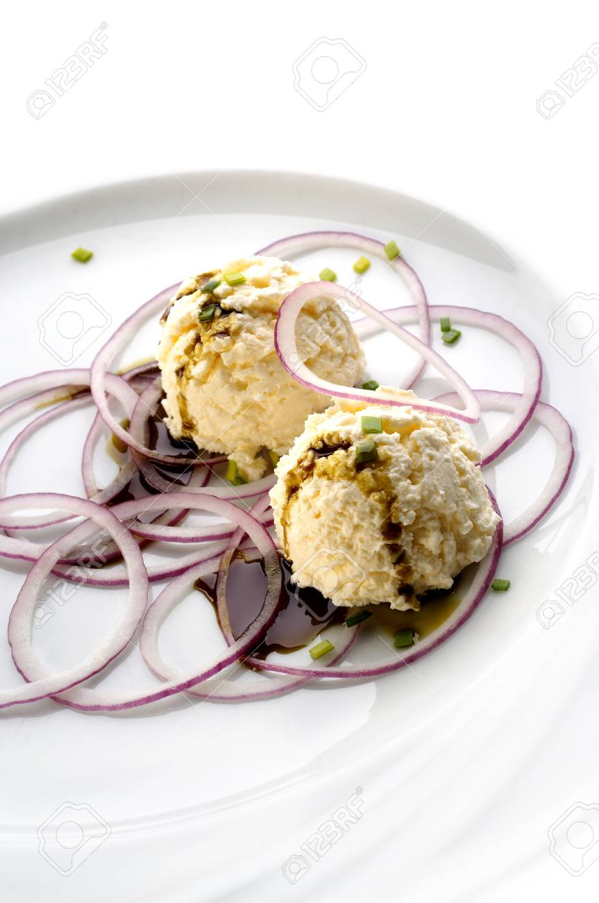 Home made curd with onion slices and pumpkin oil Stock Photo - 4065221