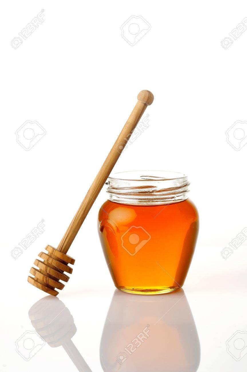 Pot of honey isolated on white Stock Photo - 4065201