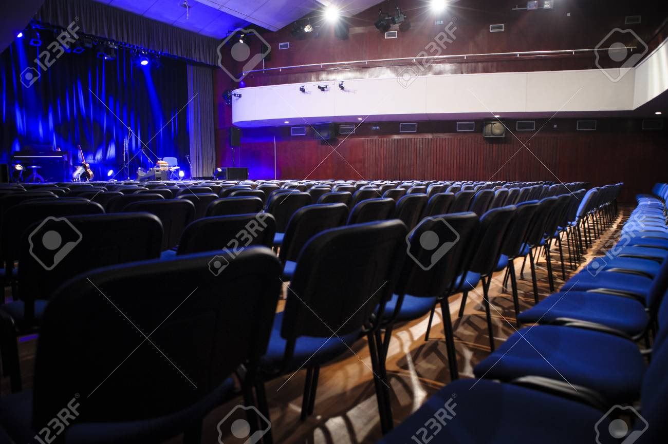 Empty Theatre Hall With Chairs Curtain Balcony And Instruments Stock Photo