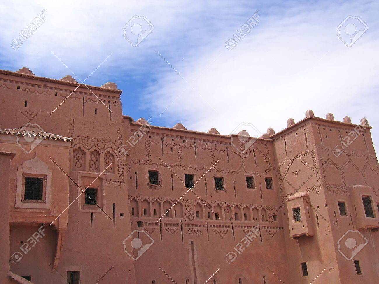 Detail of oriental maroccan architecture on a wall of a red fortress - Taourirt Kasbah - Ouarzazate - Morocco. Stock Photo - 914341