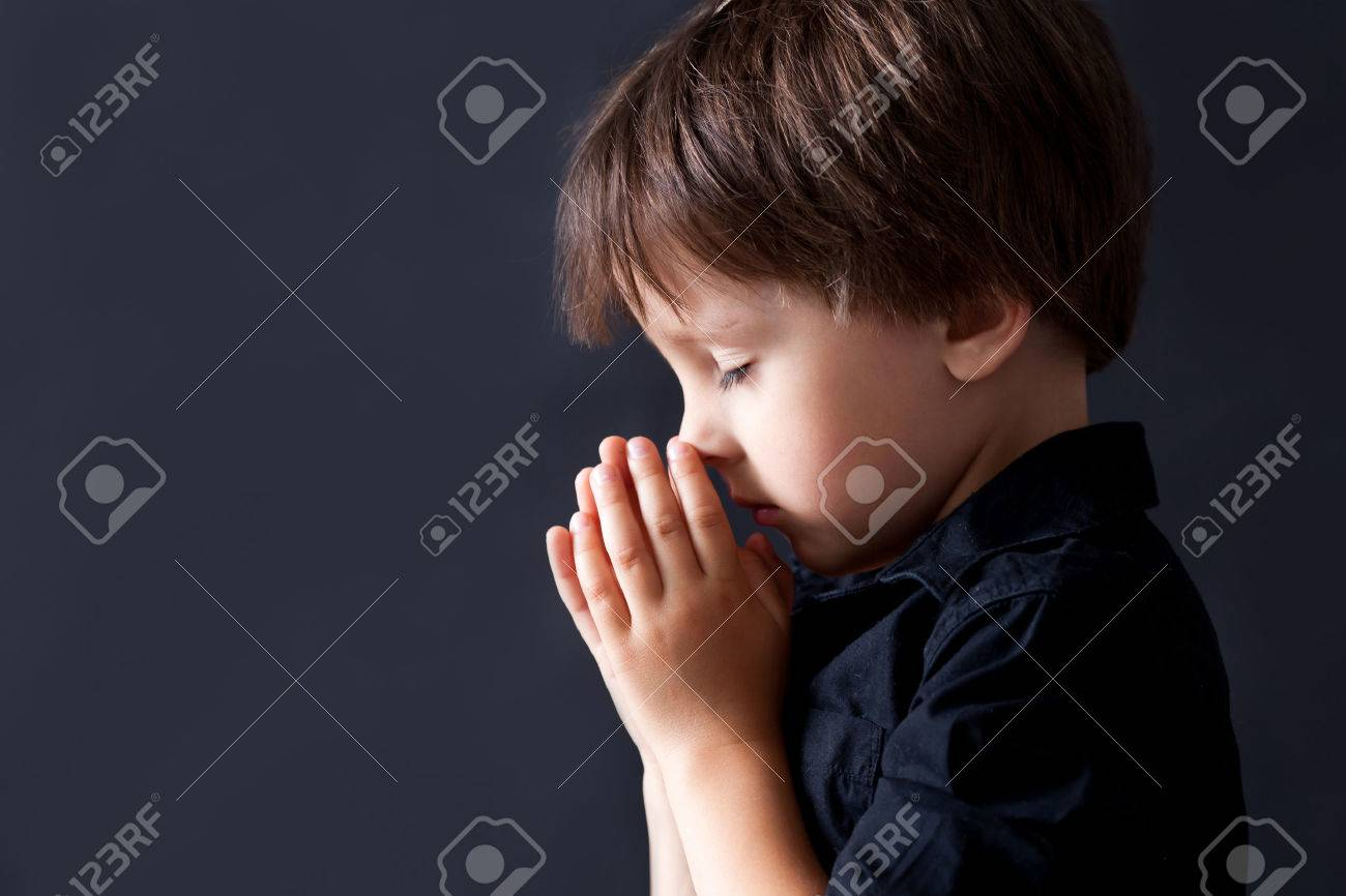 child praying images  Little Boy Praying, Child Praying, Isolated Black Background Stock ...