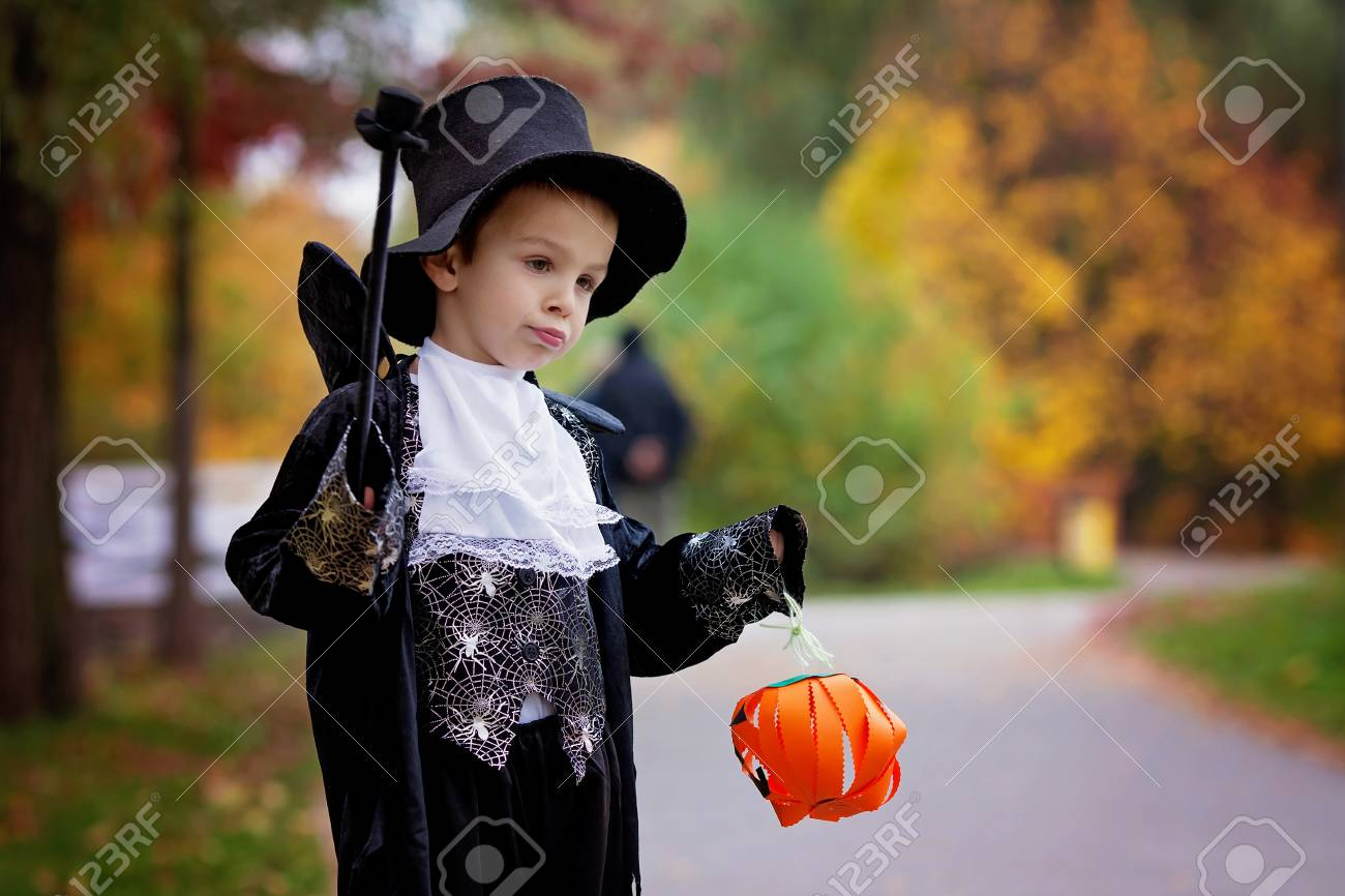 Cute boy in the park wearing magician costume for Halloween having fun Stock Photo  sc 1 st  123RF.com & Cute Boy In The Park Wearing Magician Costume For Halloween ...