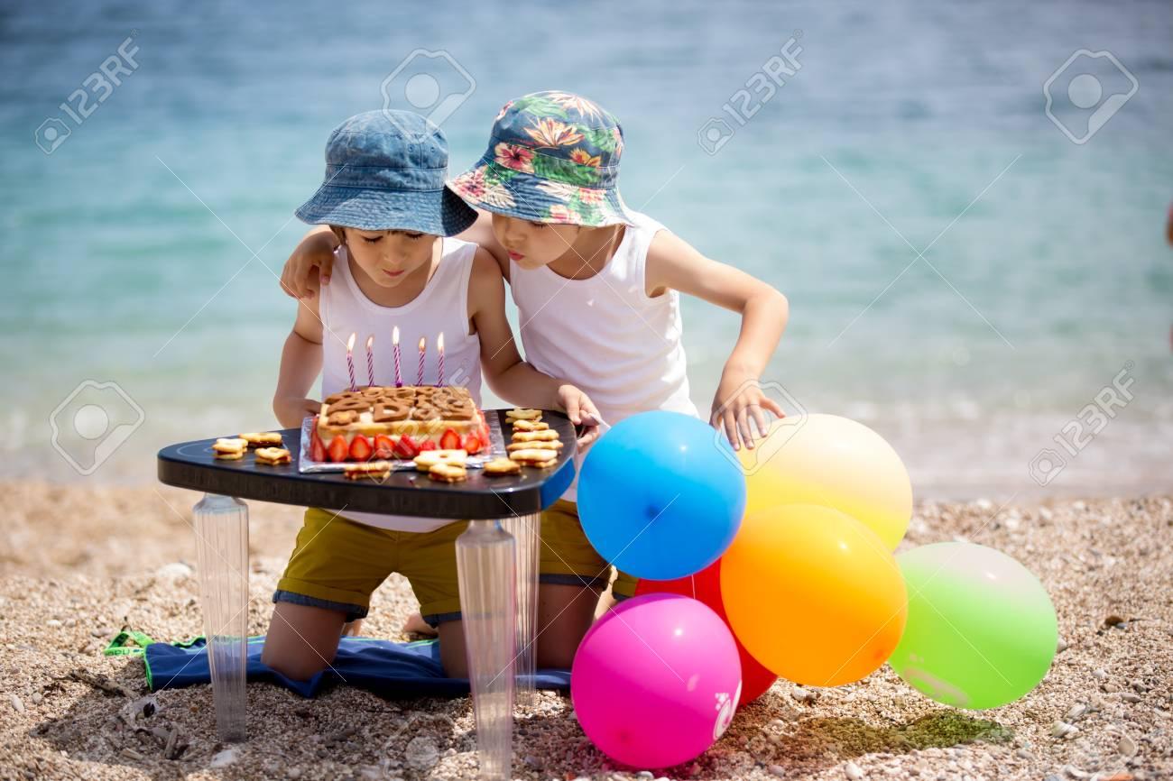 Sweet little children, twin boys, celebrating their sixth birthday