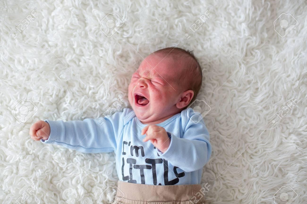 Little newborn baby crying, baby with skin rash, child dermatitis symptom problem rash, newborn suffering atopic symptom on skin. concept child health - 84899865