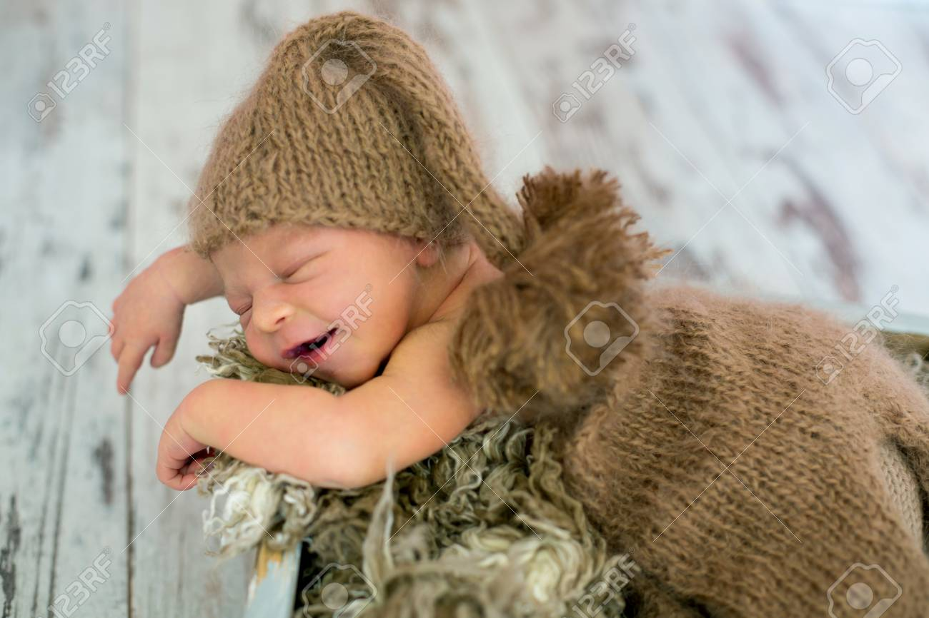 87bcddf5eb5 Happy Smiling Newborn Baby Boy In Knitted Hat And Pants