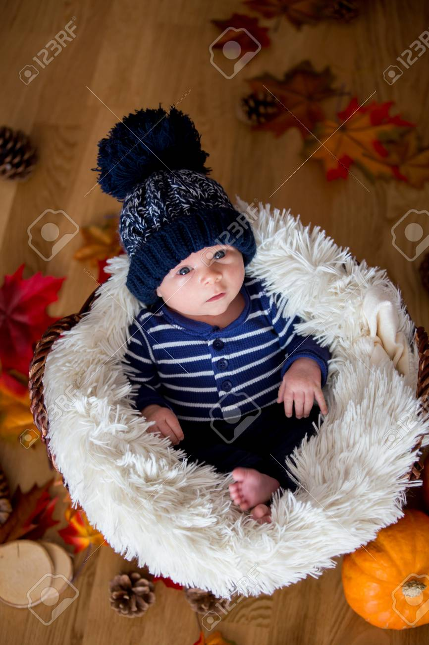 7820bf89023 Cute Newborn Baby Boy With Blue Knitted Hat In A Basket