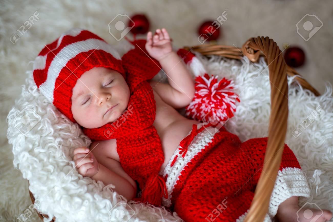 f4f4401a6 Little sleeping newborn baby boy, wearing Santa hat and pants,..