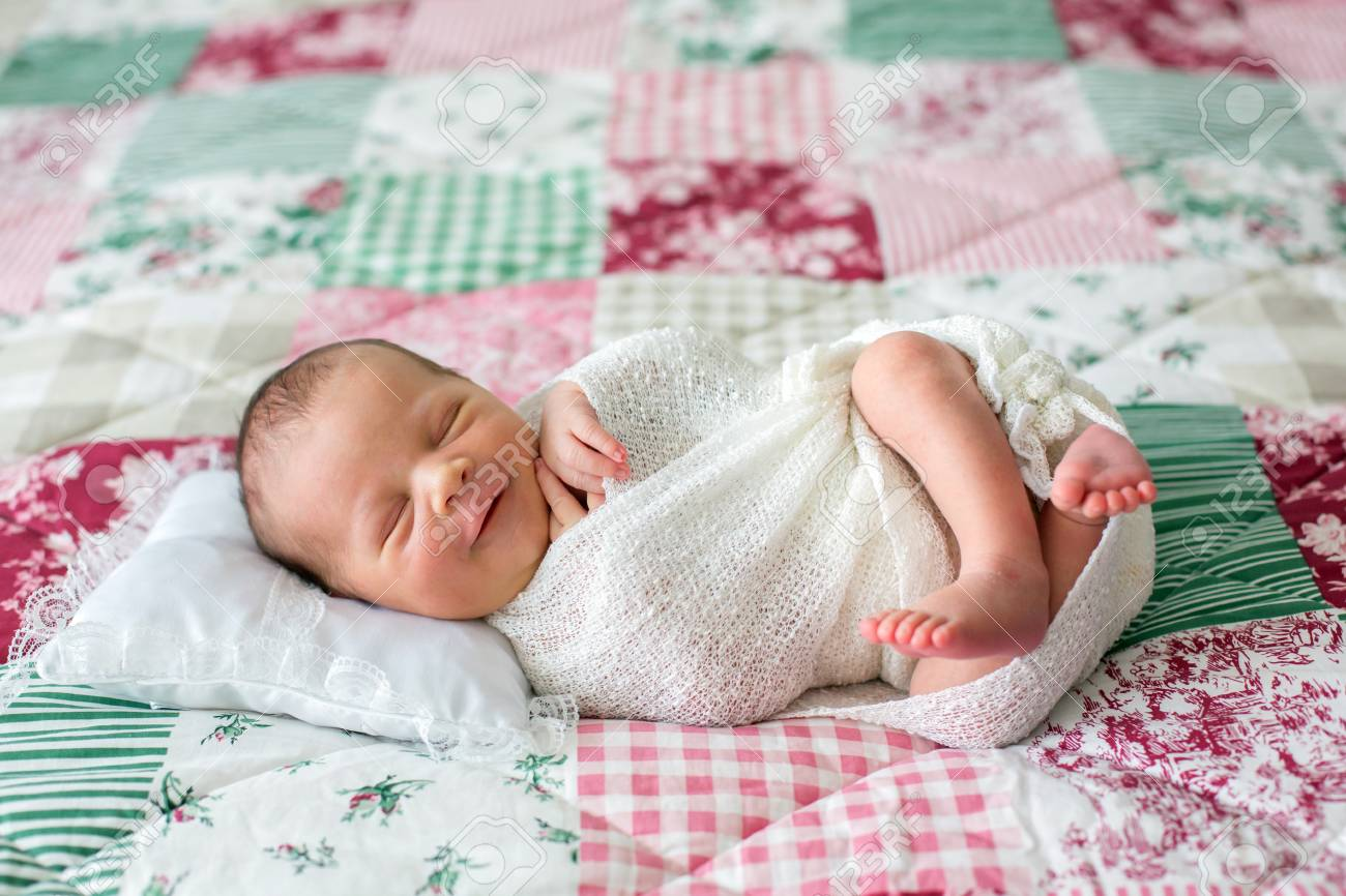 Beautiful Newborn Baby Boy Widely Smiling Wrapped In Wrap Stock