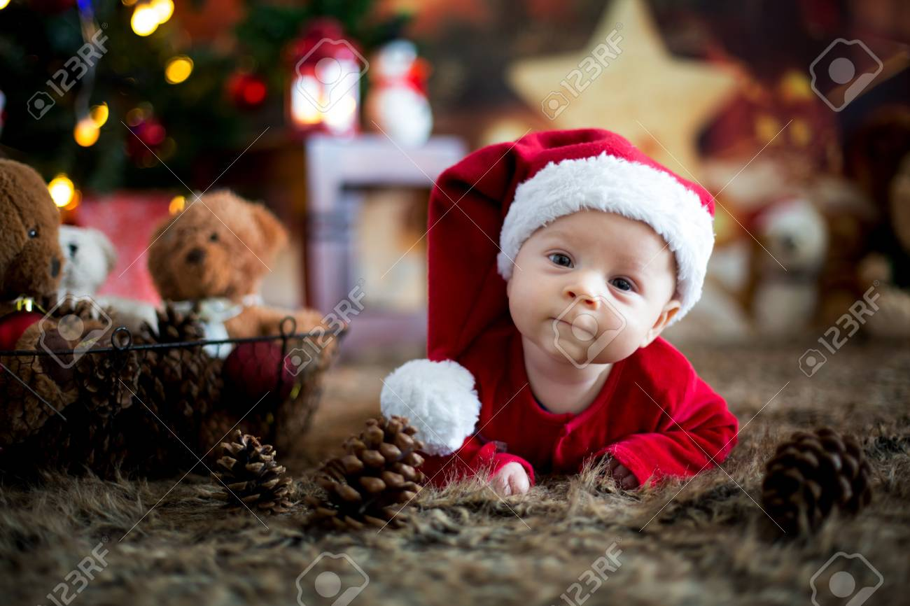 Portrait of newborn baby in Santa clothes in little baby bed, winter snow landscape outdoor - 89534341