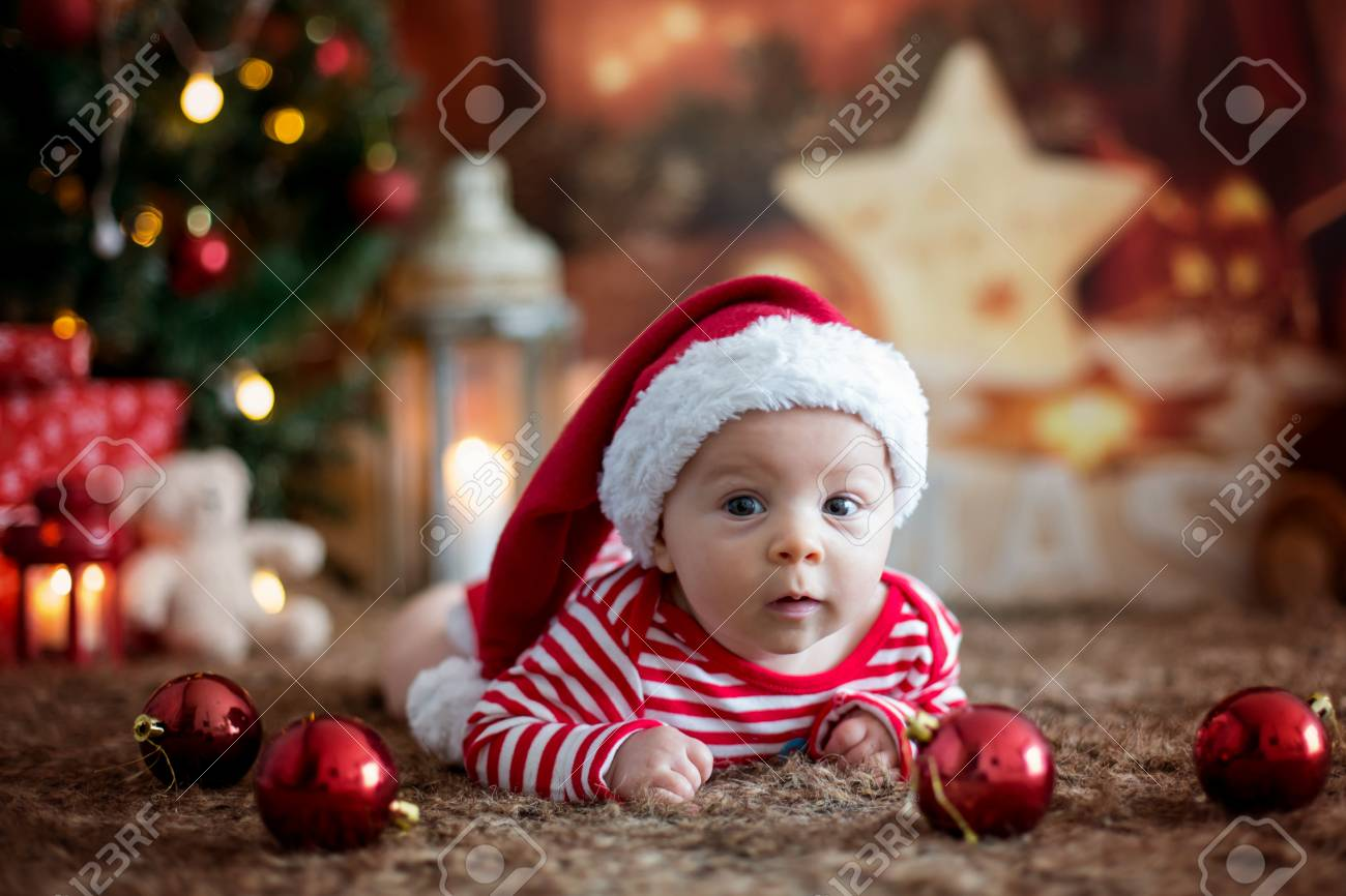 Christmas Portrait Of Cute Little Newborn Baby Boy, Dressed In ...