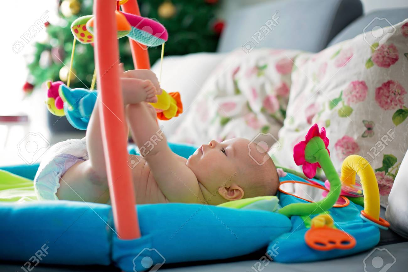 Little Baby Boy Playing With Colorful Toys At Home Newborn Stock
