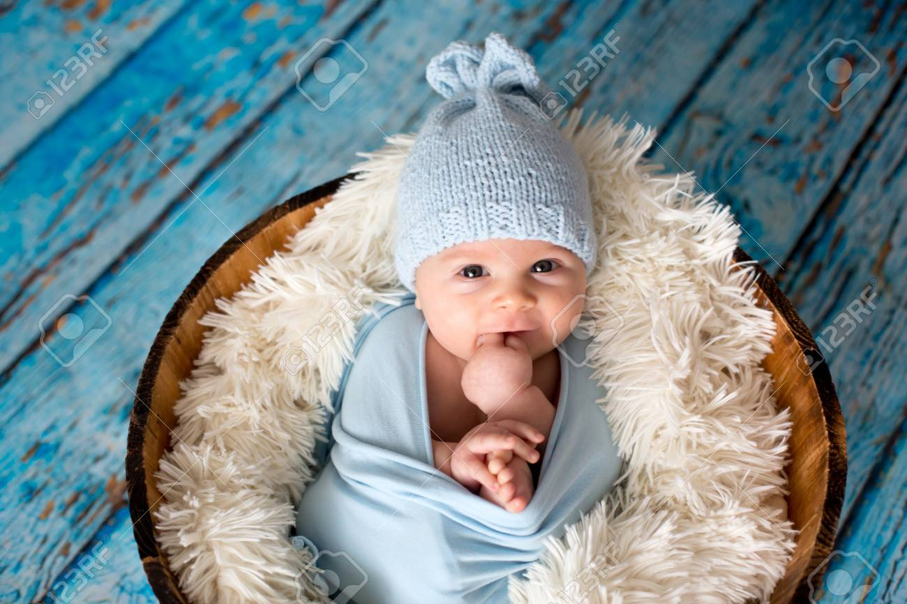 Little Baby Boy With Knitted Hat In A Basket b9f7cbea33e