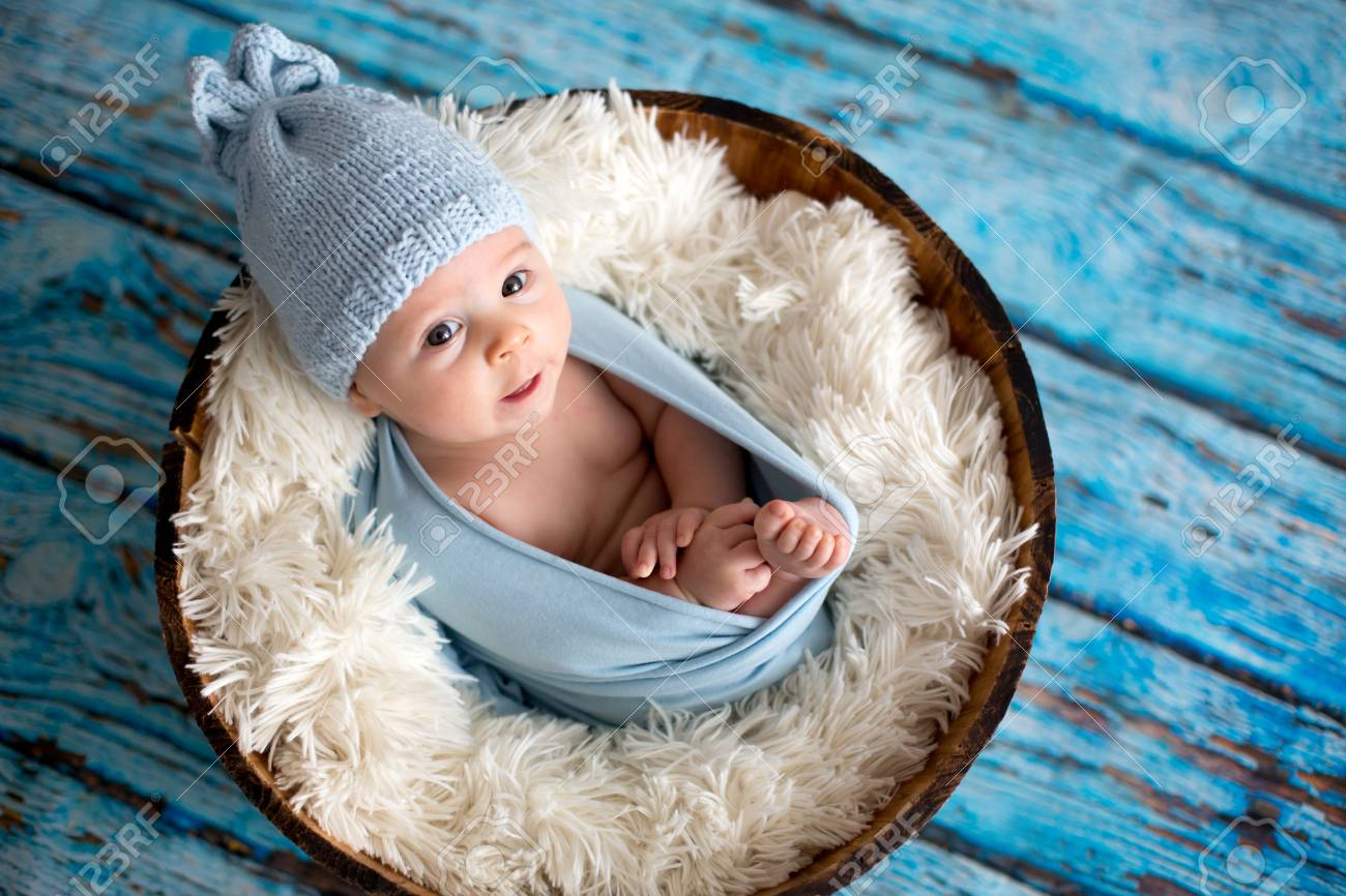 Little Baby Boy With Knitted Hat In A Basket 8d8e6cd99a1