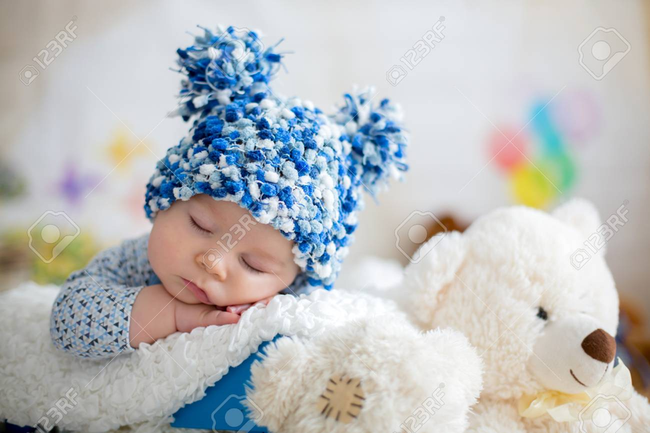 789cda3d615 Little Baby Boy With Knitted Hat