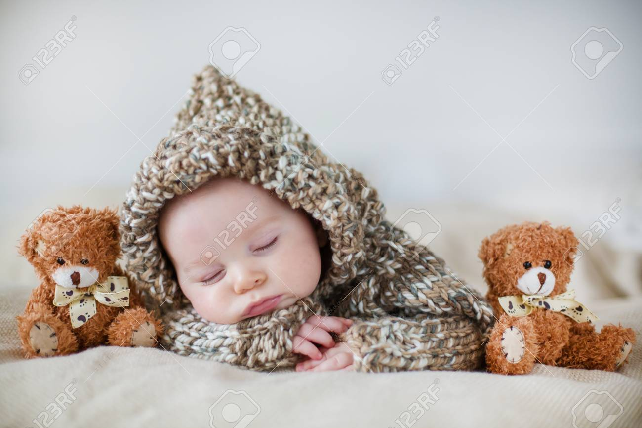 Little Baby Boy Sleeping At Home With Soft Teddy Bear Toys