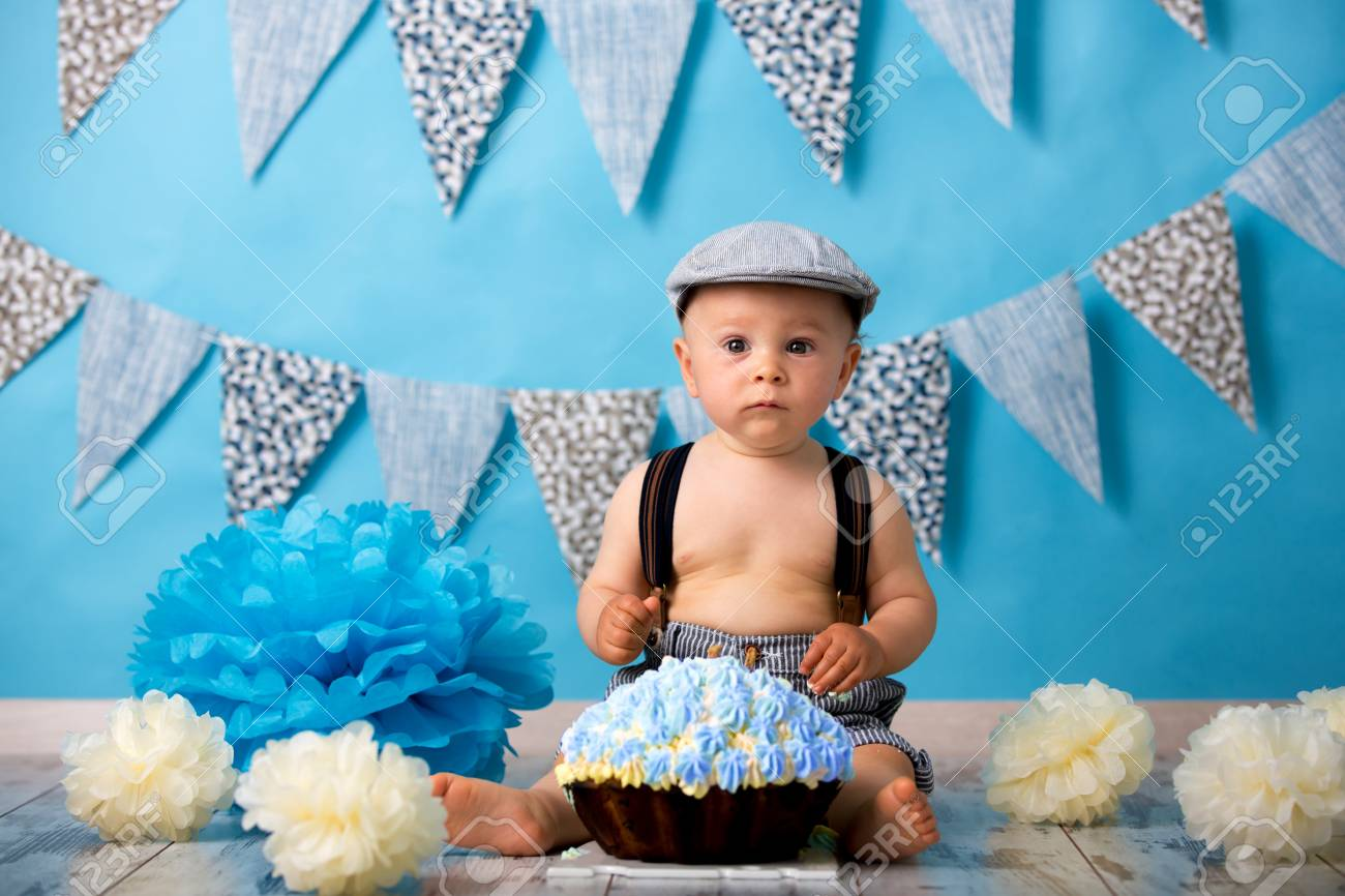 Little Baby Boy Celebrating His First Birthday With Smash Cake Party Studio Isolated Shot