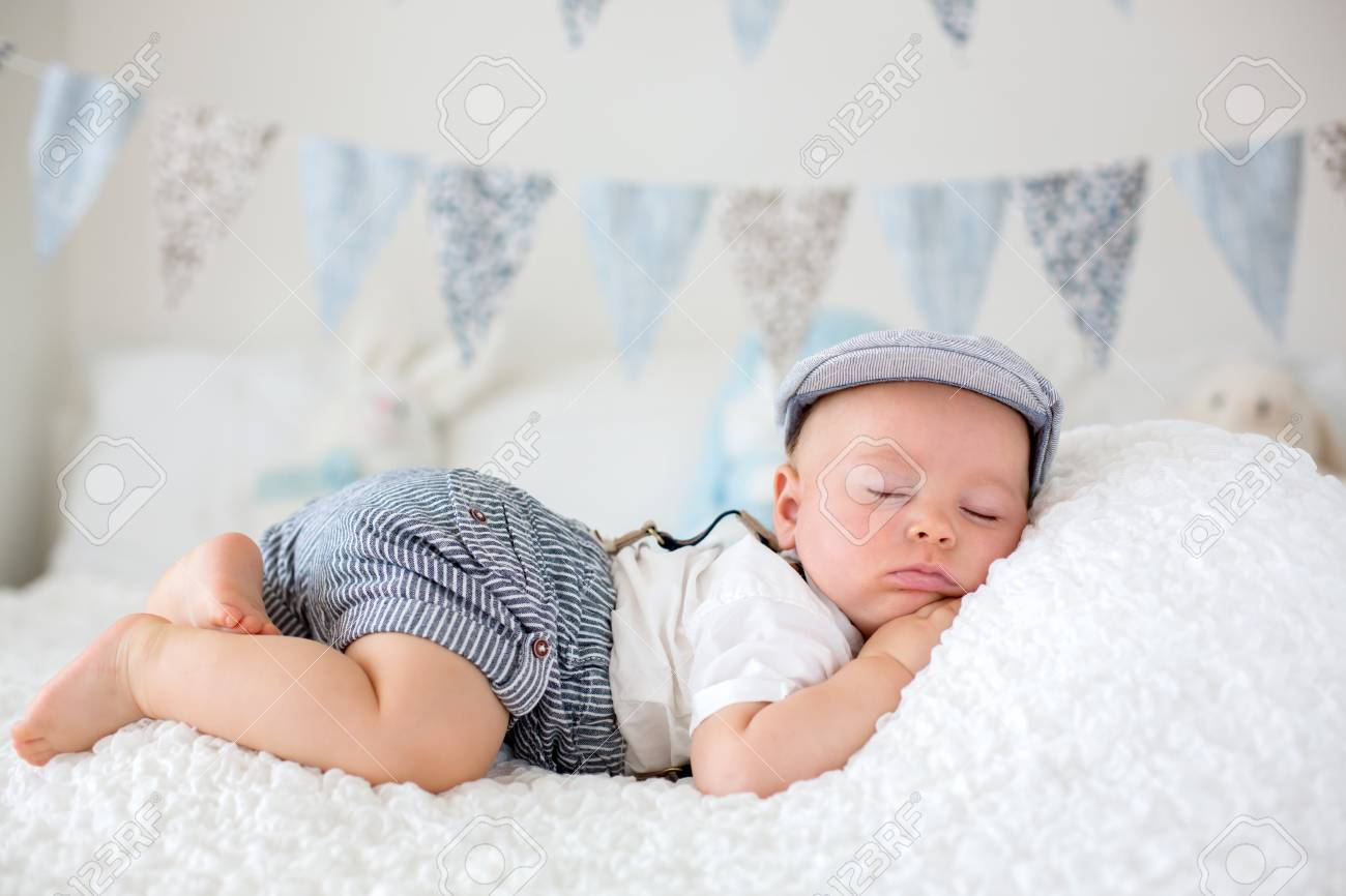 Sweet Little Child Baby Boy Sleeping In A Sunny Bedroom During Stock Photo Picture And Royalty Free Image Image 103269157