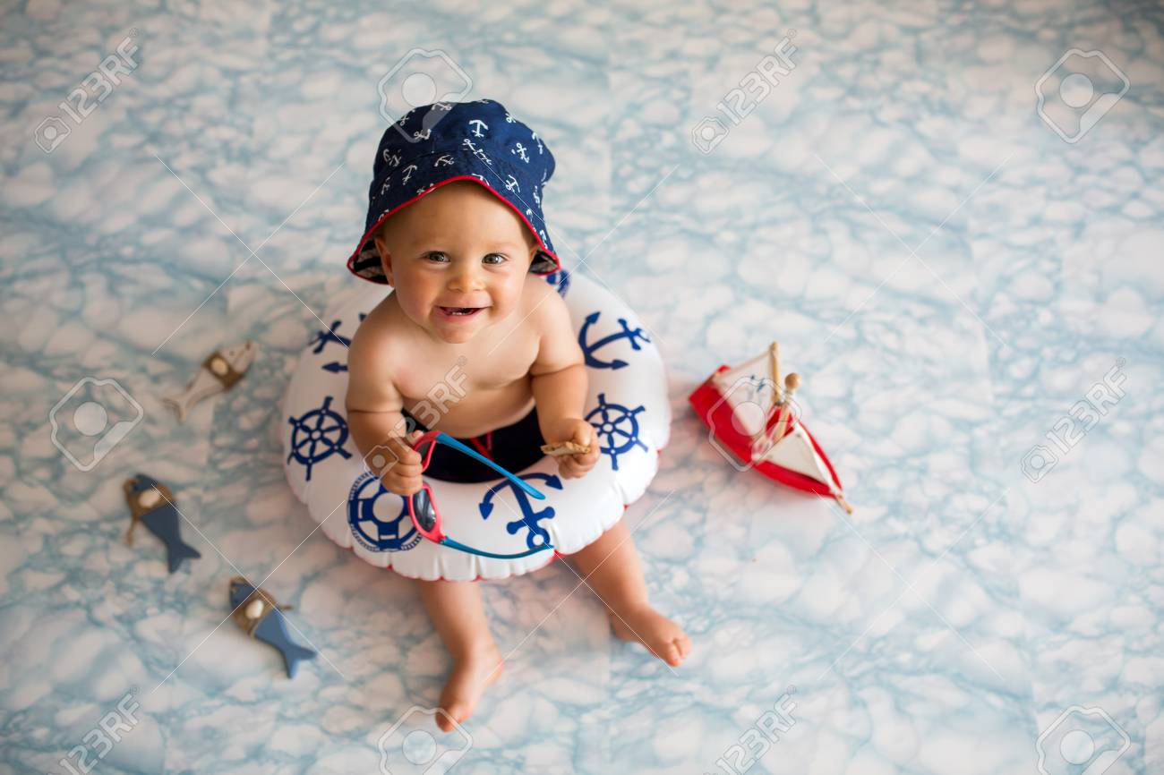 40875c2dceb9 Cute Baby Boy Lying Down On A Tiny Inflatable Swim Ring