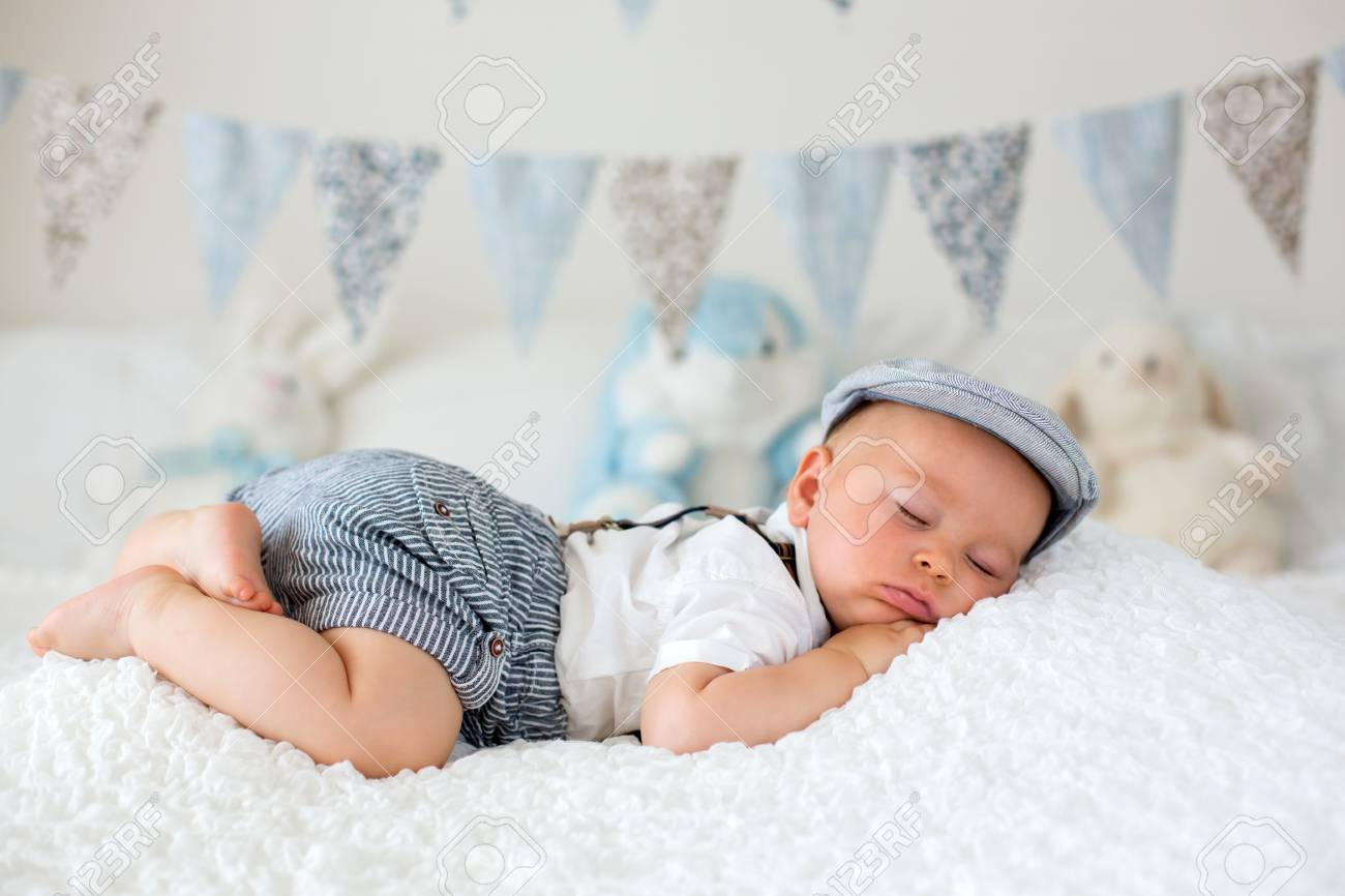 Sweet Little Child Baby Boy Sleeping In A Sunny Bedroom During Stock Photo Picture And Royalty Free Image Image 103268896