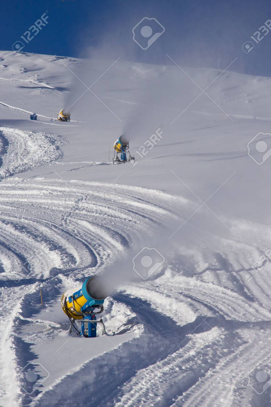 snow cannon making snow at livigno ski resort, italy stock photo