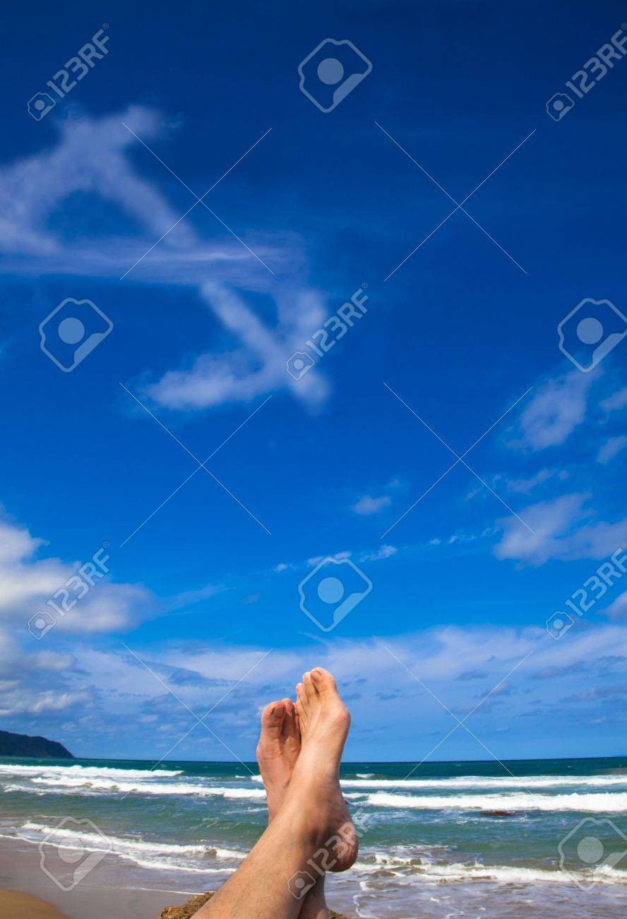 Lying on the beach with dollar symbol cloud Stock Photo - 6916877