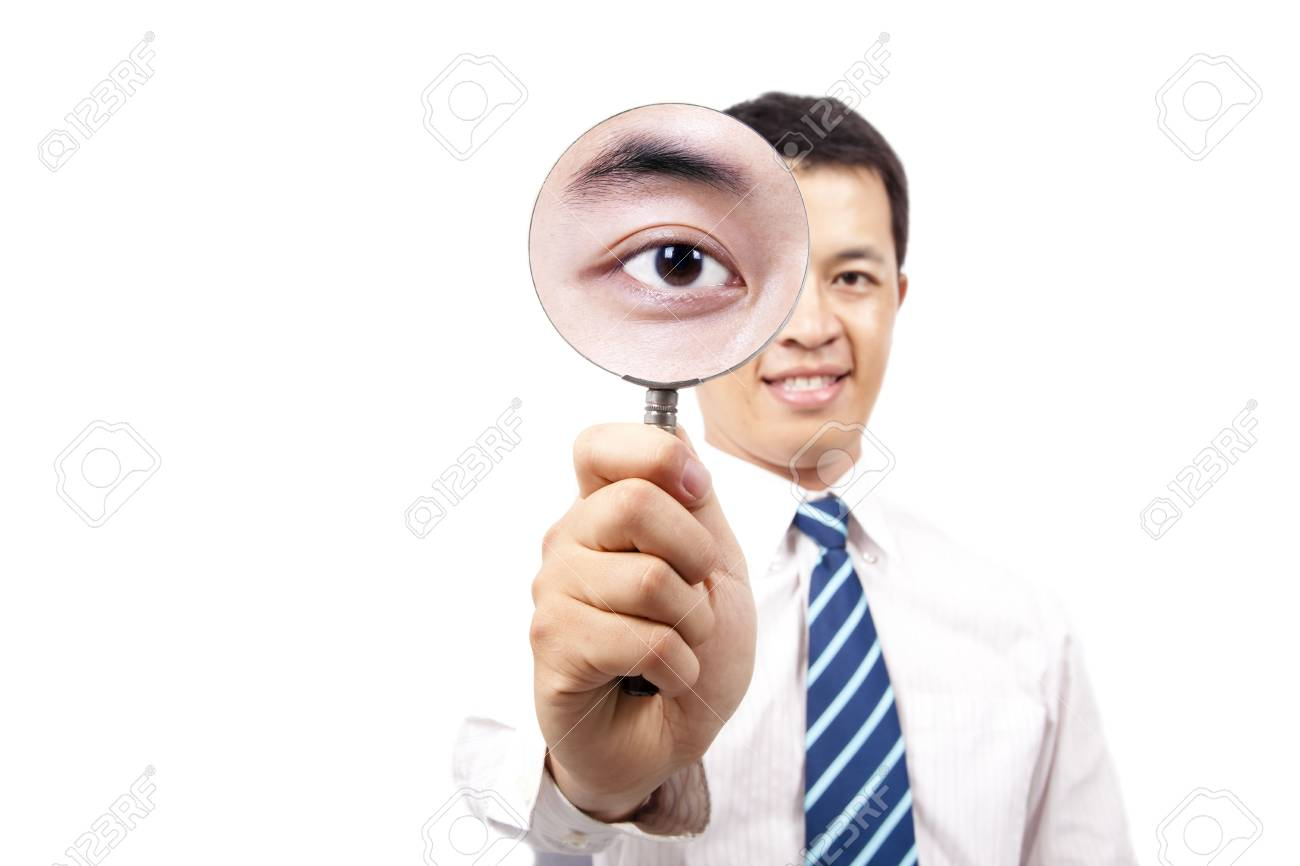 young businessman holding Magnifier and show his big eye Stock Photo - 7621571