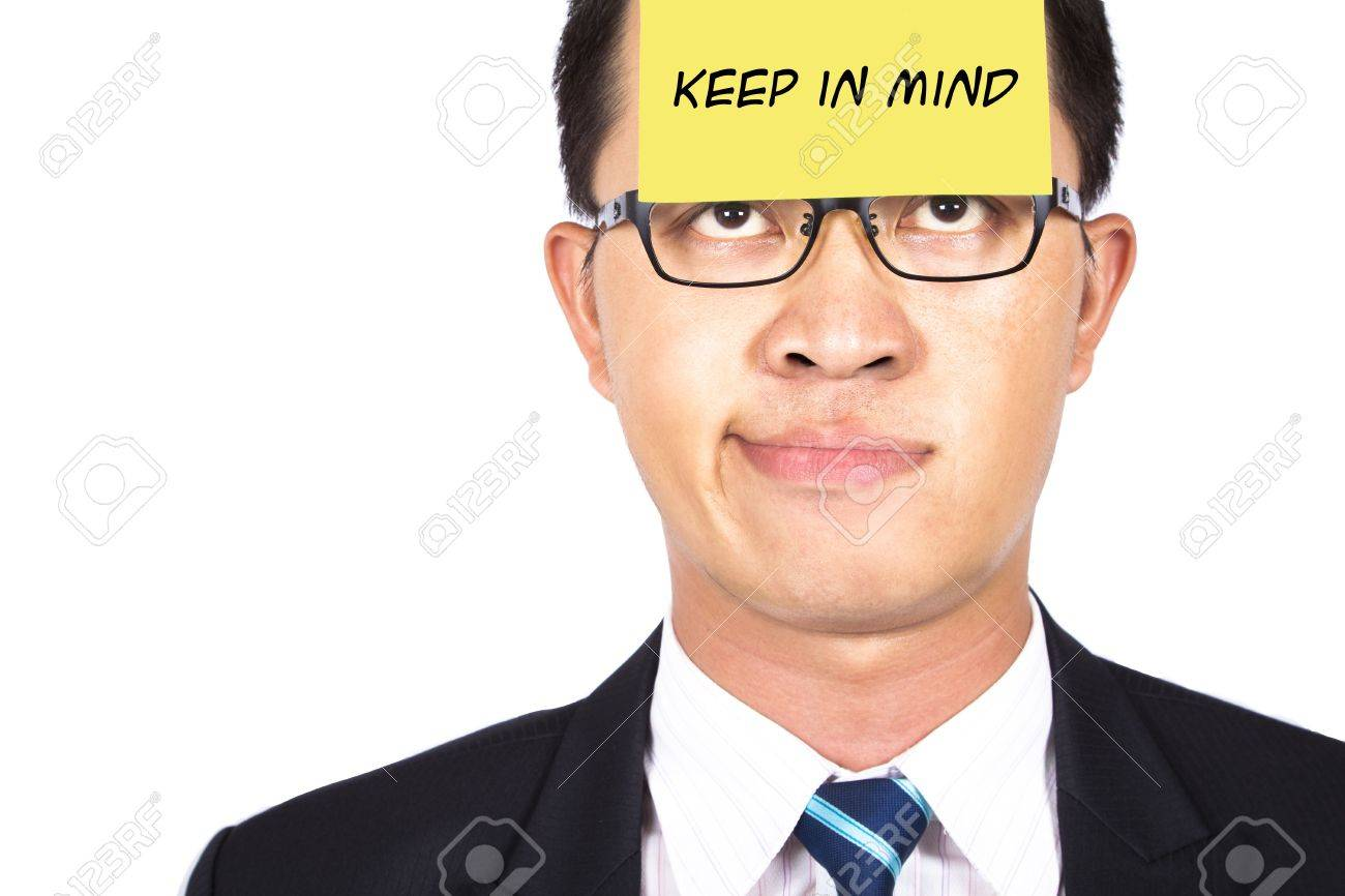 remember and keep in mind.businessman helpless watching the post it Stock Photo - 7704722
