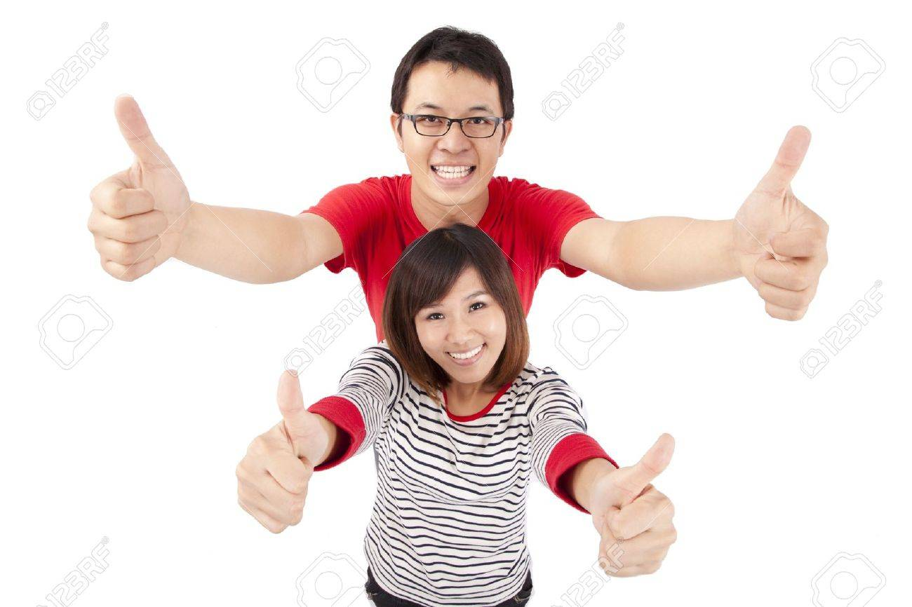 Excited young couple celebrating with thumb up Stock Photo - 8375964
