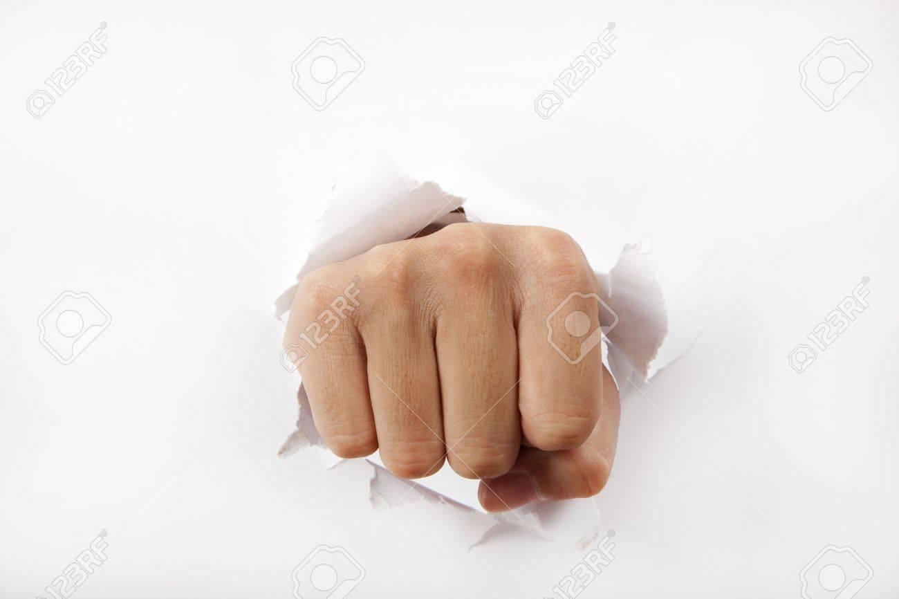 Man fist break through the white paper Stock Photo - 8375961