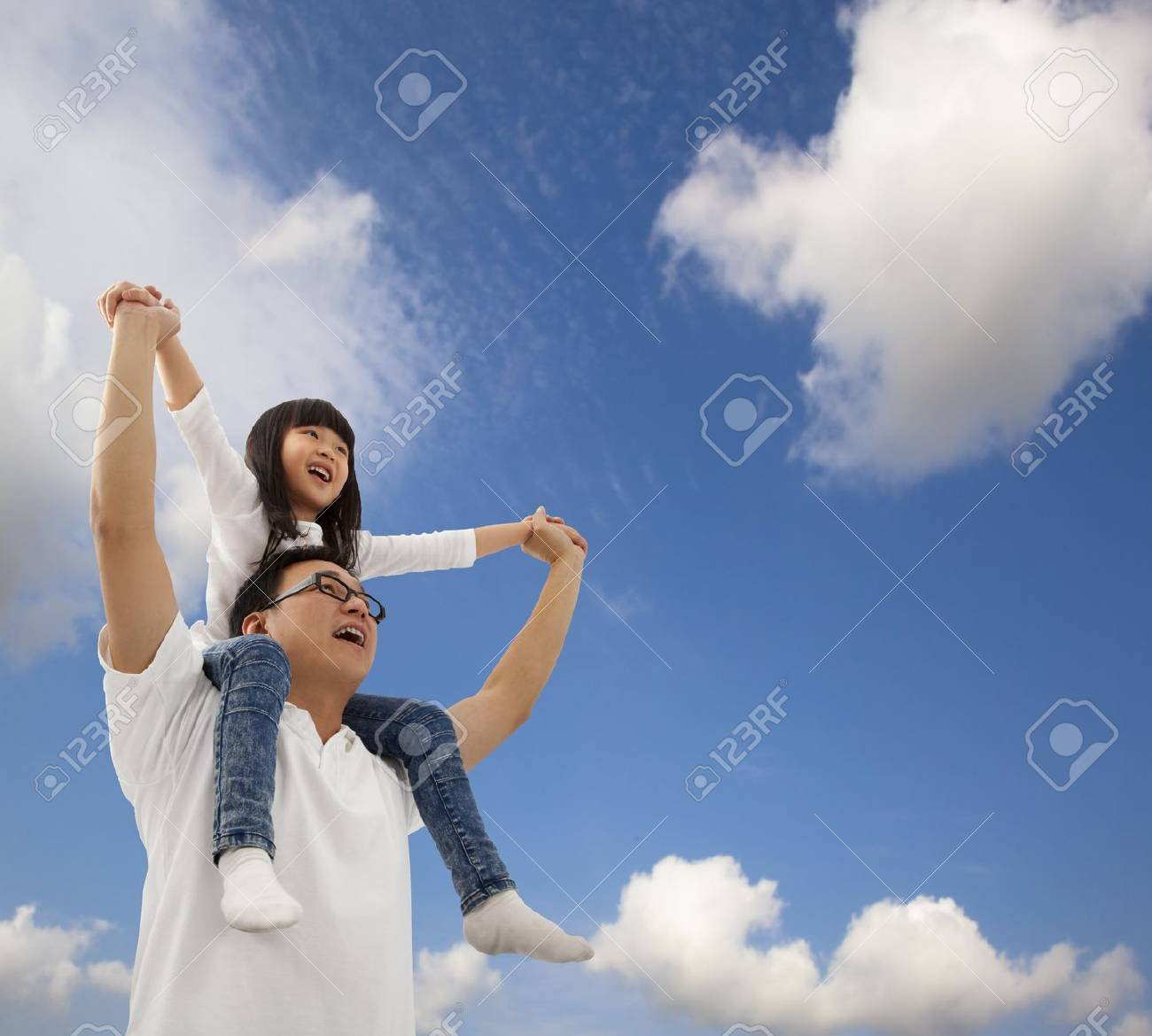 Asian father and daughterunder cloudfield Stock Photo - 8543509