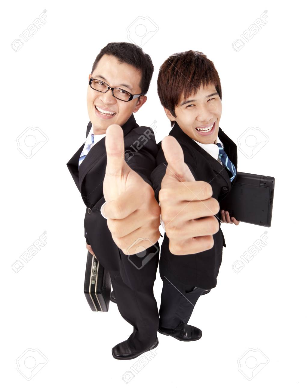 Two successful  businessman with thumb up Stock Photo - 9075982