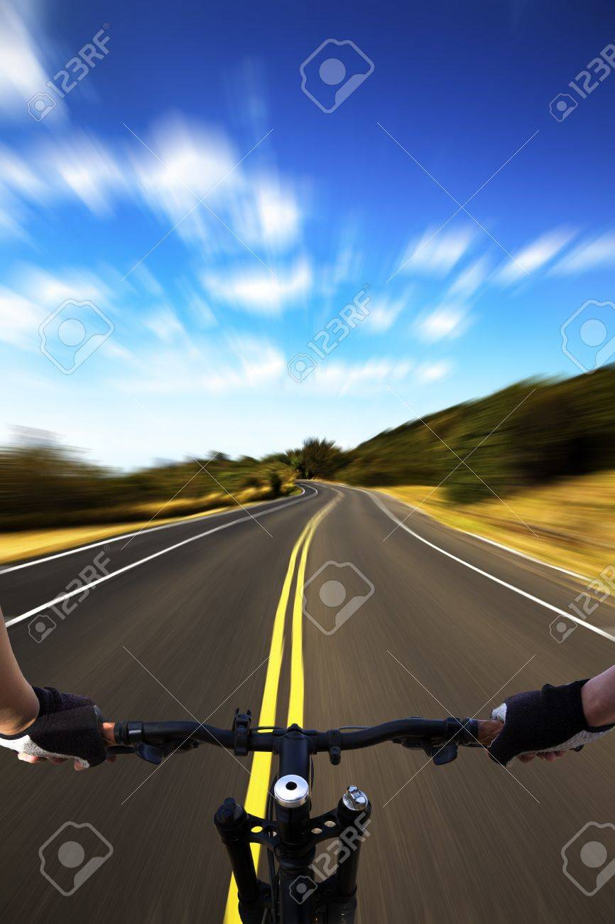 Bicycle rider with high speed view on the road Stock Photo - 9075989