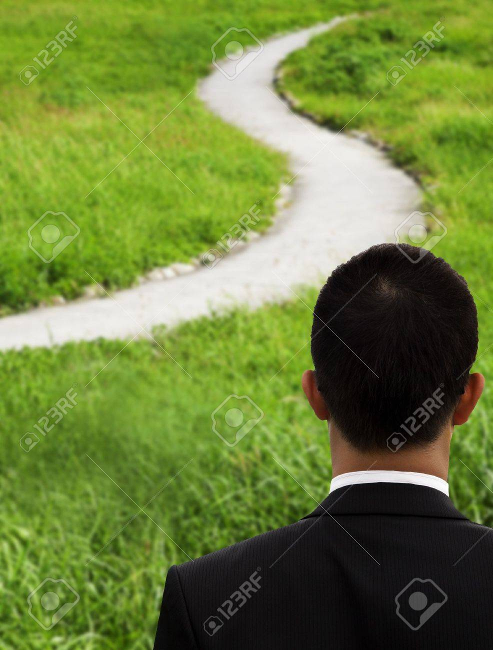 Business man thinking and watching the curved road Stock Photo - 9163417