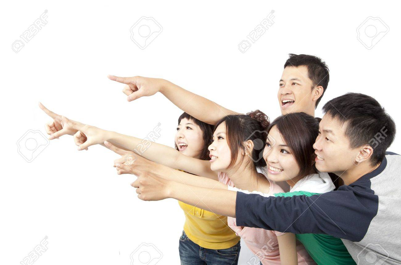 happy Asian young group pointing away isolated on white background Stock Photo - 9653749