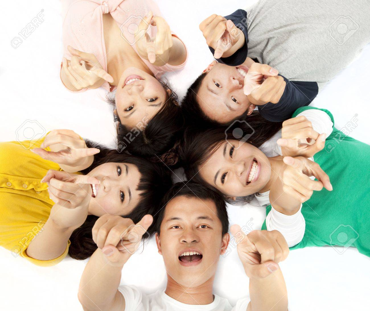 happy asian young group pointing at you Stock Photo - 9854129