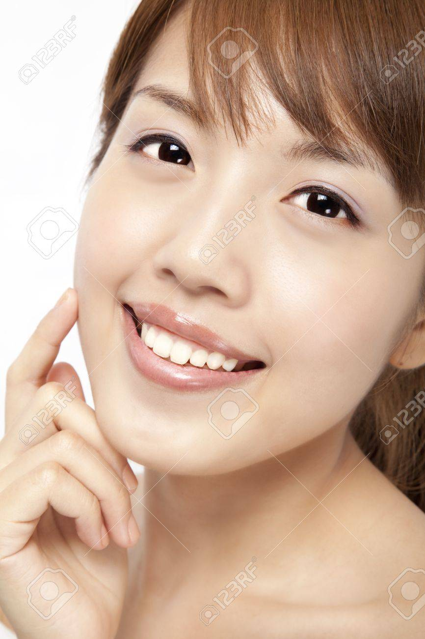 Happy beautiful asian woman's face with fresh clean skin Stock Photo - 10573660