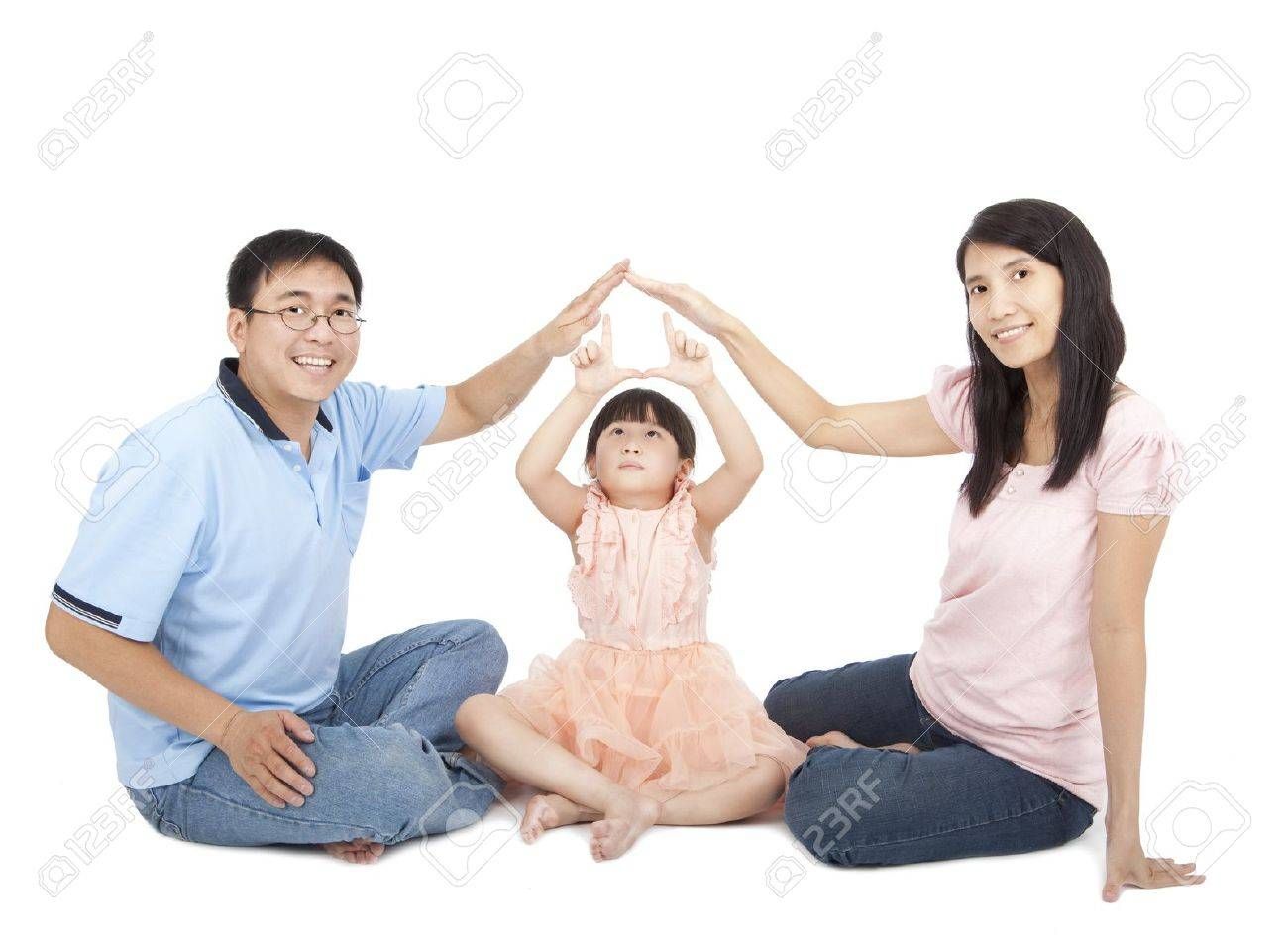happy young family showing home sign by hands Stock Photo - 10776745