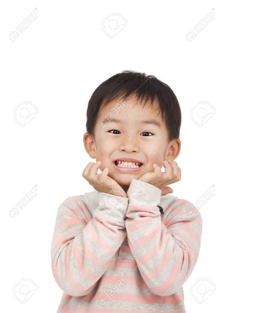 asian kid expressing surprise with his hands in his face Stock Photo - 11568020